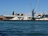 stock photo of raw materials  - Loading cargo of raw materials from a port mooring - JPG
