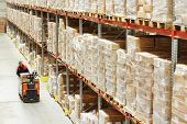 picture of pallet  - Electric forklift pallet stacker truck equipment at work in warehouse - JPG