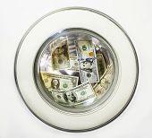 foto of twenty dollars  - Dollar bills is washed in the washing machine drum - JPG