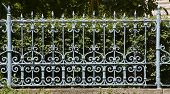 pic of old stone fence  - Old metallic fence with decorative pattern - JPG