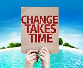 stock photo of change management  - Change Takes Time card with a beach on background - JPG