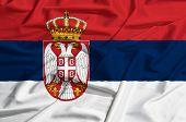 stock photo of serbia  - Serbia flag on a silk drape waving - JPG