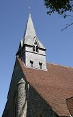 pic of church-of-england  - Wooden shingle tower and spire to Church of Saint Peter and Holy Cross at Wherwell - JPG