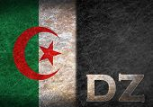 pic of algeria  - Old rusty metal sign with a flag and country abbreviation  - JPG