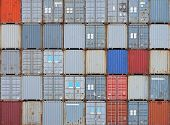 stock photo of terminator  - Stacked shipping containers at cargo logistics terminal - JPG