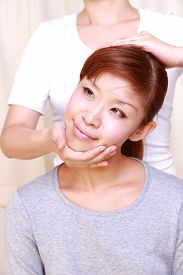 pic of chiropractic  - woman getting chiropractic in the chiropractic office - JPG