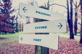 pic of past future  - Conceptual Design of Present Future and Past on Direction Sign Board on a Grassy Landscape with Trees at the Background - JPG