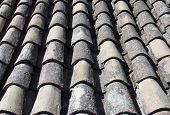 stock photo of tile  - Tiled roof sections make a tile background from the clay tiles - JPG