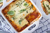 picture of zucchini  - Healthy zucchini lasagna bolognese in a baking dish - JPG