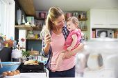 picture of two women taking cell phone  - Mother Taking Selfie On Mobile Phone Holding Young Daughter - JPG