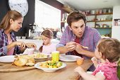 foto of 11 year old  - Family Eating Meal In Kitchen Together - JPG