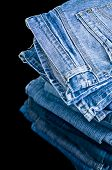 stock photo of denim jeans  - Piled Denim jeans - JPG