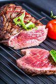 image of porterhouse steak  - Grilled Beef steak with vegetable decoration - JPG