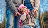 picture of father time  - Closeup of happy little girl enjoying with her fathers of leisure in the forest - JPG