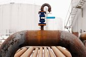 foto of valves  - Oil and gas pipeline valve on rusty piping - JPG