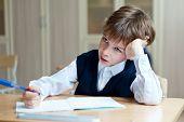 picture of diligent  - Diligent preschool sitting at desk in classroom - JPG