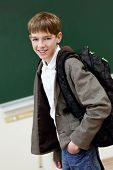 foto of schoolboys  - Portrait of a schoolboy at blackboard background - JPG