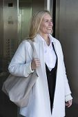 pic of elevators  - blond woman coming out of an elevator - JPG