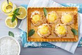 stock photo of curd  - Coconut macaroon cookies filled with lemon curd - JPG