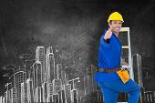 stock photo of step-ladder  - Repairman gesturing thumbs up while climbing step ladder against hand drawn city plan - JPG