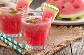 stock photo of watermelon  - Watermelon drink in glasses with slices of watermelon - JPG