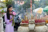 stock photo of buddhist  - Vietnamese Buddhist woman praying in temple - JPG
