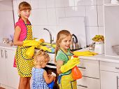 stock photo of pinafore  - Children little girl cooking at kitchen - JPG