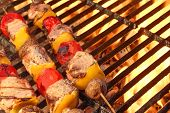 foto of bbq party  - Mixed Meat And Vegetable Kebabs On The Hot BBQ Grill Closeup - JPG