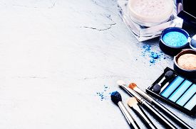 stock photo of cosmetic products  - Various makeup products in blue tone with copyspace - JPG