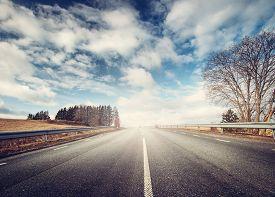picture of spring-weather  - black asphalt road on sunny spring day - JPG