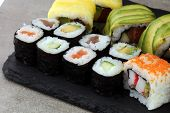 Close Up Of Sashimi Sushi Set With Chopsticks And Soy - Sushi Roll With Salmon And Sushi Roll With S poster