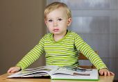 picture of pop up book  - 2 years old baby boy reading book - JPG