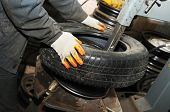taking off tyre from car wheel disc for repair (replacement)