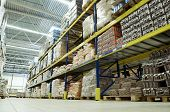 stock photo of food truck  - long stack arrangement of goods in a wholesale and retail warehouse depot - JPG