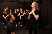 Male And Female Drama Students At Performing Arts School In Studio Improvisation Class poster