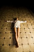 pic of seminude  - Young seminude crucified woman on the floor - JPG