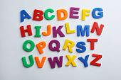 Plastic Magnetic Letters Isolated On White, Top View. Alphabetical Order poster