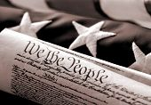 We The People - Sepia toned conceptual image of US flag and Constitution