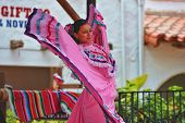 SAN DIEGO, CALIFORNIA - JUNE 26: A dancer performs folklorico on a stage at Old Town in celebration