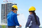 stock photo of commercial building  - Two contractors - JPG