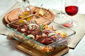 stock photo of deer meat  - fresh raw deer meat in a glass bowl - JPG
