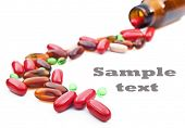 a Colorful stream of pills coming from a pill bottle - on a white background with space for text