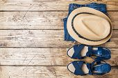 Summer Womens Clothes. Flat Lay Fashion Photo. Blue Jeans, Sun Hat, Blue Sandals On Wooden Backgroun poster