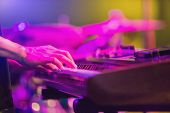 Musicians Hands Playing Keyboard At A Live Show On Stage With Blurry  Musical Instrument poster
