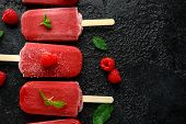 Homemade Raspberry Popsicles, Ice Lolly On Rustic Black Background poster