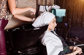 Beautiful Woman Washing Hair In A Hair Salon poster