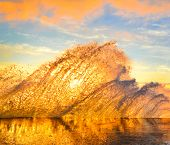 Sea Splash. Morning Seascape With Splashes At Sunrise poster