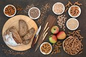 Health food for a high fibre diet with apples, whole grain rye bread, whole wheat pasta, oatmeal, oa poster