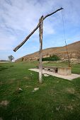image of shadoof  - Wooden well on rural countryside in Serbia - JPG