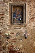 Picture of madonna or saint on an old wall